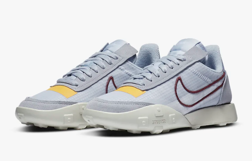 Light blue Nike Waffle Racer 2X with yellow and burgundy accents